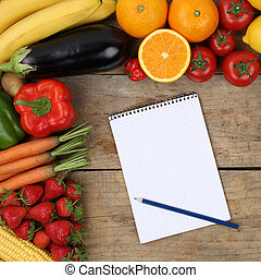 Shopping list with fruits and vegetables on a wooden board