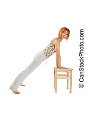 Fitness girl on white - Young red-haired fitness girl...