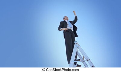 Businessman Ladder Champion Fist - A businessman in a suit...