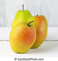Pears on white wood