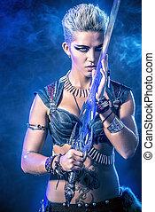 muscular woman - Portrait of a beautiful female warrior in...