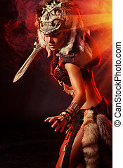 young warrior - Beautiful bellicose Amazon with a sword in...
