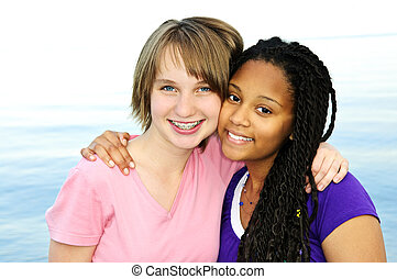 Happy teenage girlfriends - Portrait of two happy teenage...