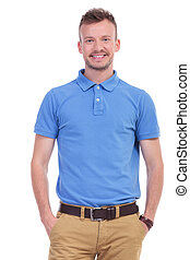 casual young man with hands in pockets - picture of a young...