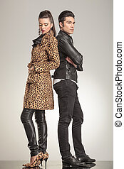 young fashion couple looking away from the camera. - Full...