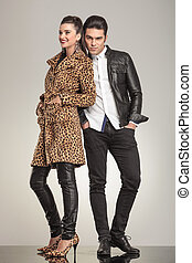 young fashion couple posing for the camera - Full length...
