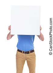 casual young man with board in front of face - picture of a...