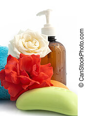 Simple set for bathroom with fresh roses on the white...