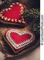 Heart cookies - Red heart shaped cookies decorated with...