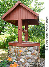 Water well in summer garden