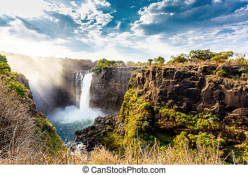 The Victoria falls with dramatic sky - The Victoria falls is...