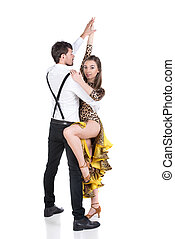 Dancing - Beautiful couple of professional dancers on the...
