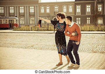 retro photo of surprised man with woman in old town are...