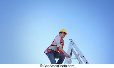 Woman Worker Climb Ladder Raise Han - Woman construction...