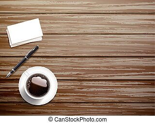 top view of stationery and coffee over wooden table