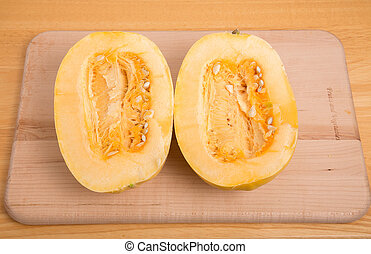 Halved Spaghetti Squash on Cutting Board - Pair of Halved...