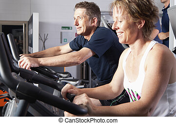 Mature couple at fitness centre - Mature couple wotking out...