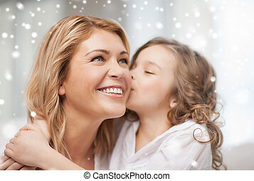 happy mother with daughter hugging and kissing - people,...