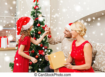 smiling family decorating christmas tree at home - family,...