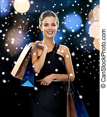 smiling woman with shopping bags - luxury, holydays, people...