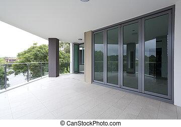 Empty balcony off modern Australian appartement