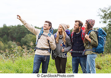 group of friends with backpacks taking selfie - adventure,...