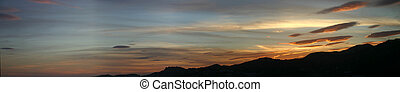 Lenticular Clouds - A fleet of lenticular clouds invading...