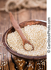 Portion of Quinoa on vintage wooden background; close-up...
