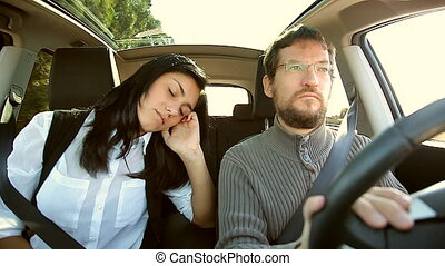 Woman sleeping in car - Man driving while girlfriend is...