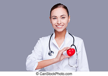 Keep your heart healthy. Confident female doctor in white...