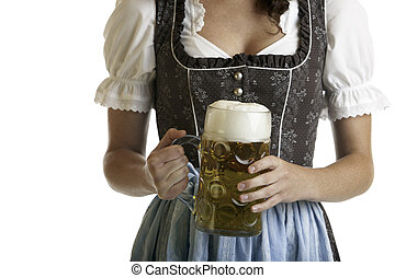 Close-up of a Bavarian Girl dressed with a traditional Dirndl cloth holding a full Oktoberfest Beer Stein in her hands
