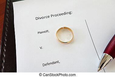 divorce ring - Divorce document with broken ring and pen...
