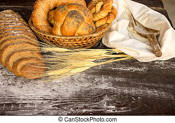 bakery food - Bakery products in wicker basket on a wooden...