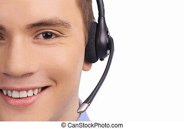 Closeup of smiling customer service agent with headset Call...