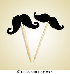 moustaches with retro effect - a pair of moustaches in...
