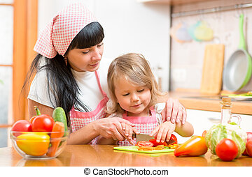 woman and kid girl preparing healthy food - woman and kid...