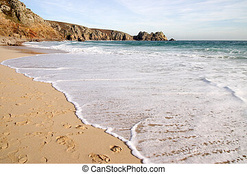 The tide coming in on a sunny day, Porthcurno, Cornwall, UK