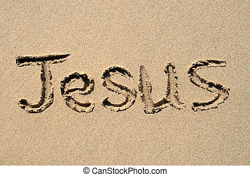 Jesus, written on a sandy beach.