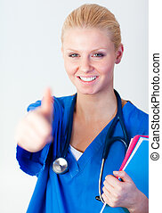 Doctor with her thumb up with focus on face