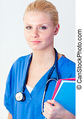 Young female doctor holding a folder - Young attractive...