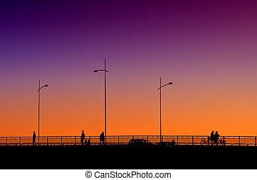 People on the bridge in sunset - Silhouettes of people...