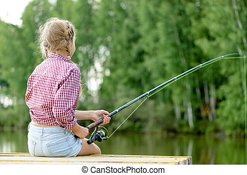 Summer fishing - Back view of girl sitting on pier with rod