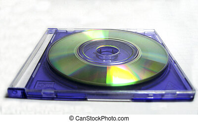 Compact disk lay over blue clear box