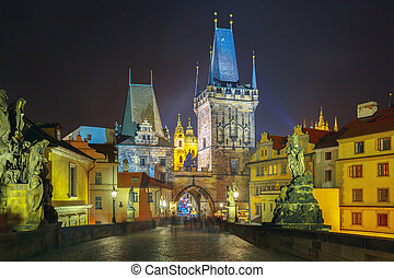 Charles Bridge in Prague (Czech Republic) at night lighting...