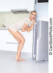 Indecisive woman raiding the fridge