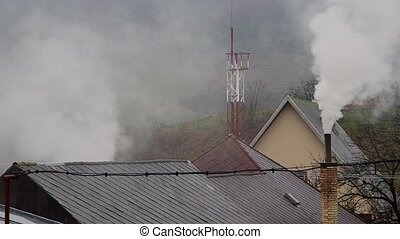 Smoke from the chimney in rainy weather