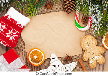 Christmas food and decor with snow fir tree background with...