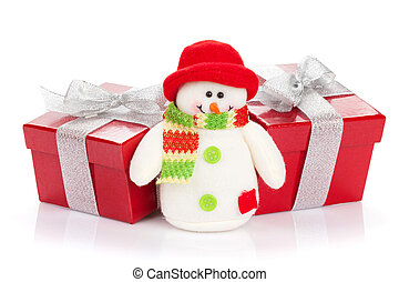 Christmas gift boxes and snowman toy