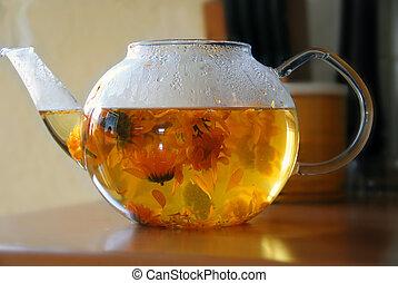 Calendula tea - tea from calendula flowers in glass...