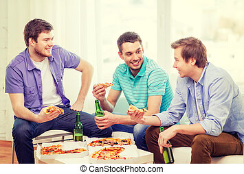 smiling friends with beer and pizza hanging out -...